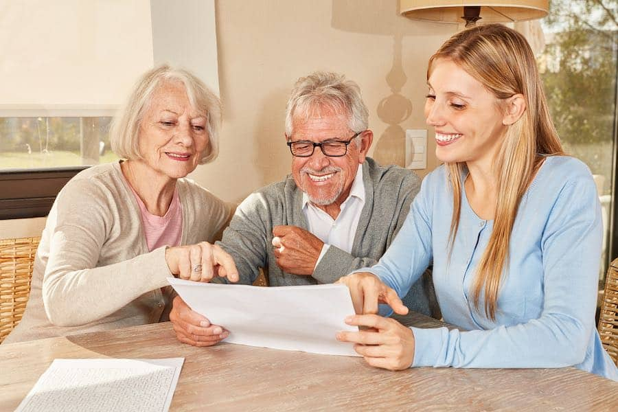 A daughter working with her parents to help them start planning their downsizing transition.