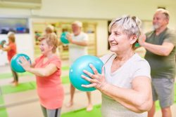 A group of seniors participating in a group exercise class to keep themselves active during the winter months.
