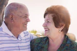 A senior couple enjoys a special moment together.