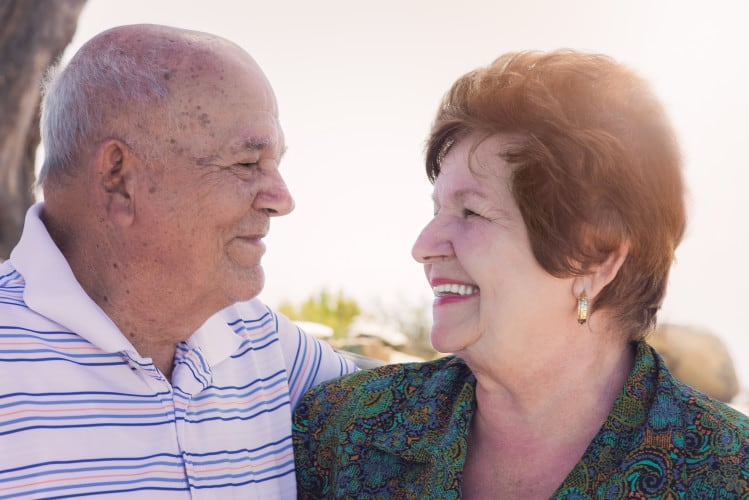 A senior couple enjoys a special moment together.